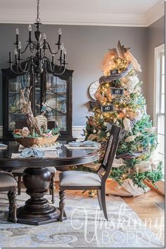 Christmas tree in the dining room with plaid accents