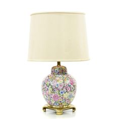 This decorative asian lamp is featured in a ceramic with colorful painted flowers in pink, green, blue and yellow. This table lamp has a large white curved shade, a brass base and round vase body. Perfect for accenting a side table! #asian #decor #lighting #sandiegovintage #vintagefurniture