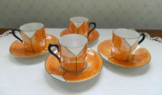 Czech Art Deco Orange Luster Demitasse Cups and Saucers