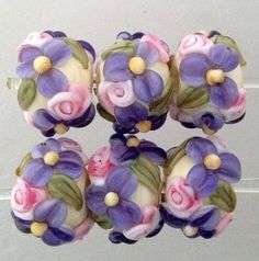 """Rosy pink, sparkly lavender and ivory, such a pretty color combination. Includes: 6 floral rounds approximately 11 mm from hole to hole. Beads were wound on a 3/32"""" mandrel and kiln annealed for s"""