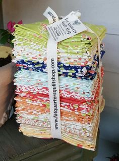 Manager Cindy and our fabulous Quilt Shop staff already have the Coney Island bundles ready for YOU!!! Designed by Fig Tree & Co. for Moda... 40 fat quarters per beautiful bundle of fabric joy ;)