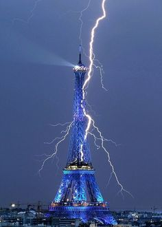 bettyboop57:      This remarkable shot of a forked lightning bolt streaking through the sky behind the 1,063ft iron tower was captured by amateur photographer Bertrand Kulik.