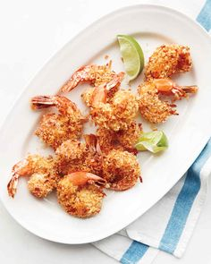 Coconut crusted shrimp. Dijon mustard helps the coating of panko breadcrumbs and shredded coconut stick to the shrimp in this tropical-inspired dish.