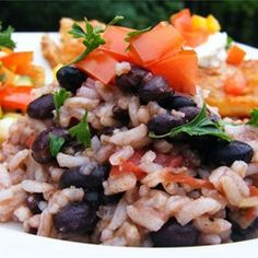 Quick Black Beans and Rice - Allrecipes.com (I used fresh minced garlic, olive oil, a can of Rotel, and rinsed my black beans. Very good!)