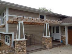 "6"" exposure Hardie Plank siding, New columns with stone base,Ipe decking and trellis"