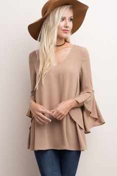 You've finally found the blouse that goes with everything! This nude, taupe blouse features beautiful bell sleeves that hit above the elbow to add a little bit a drama to any outfit! The smooth color