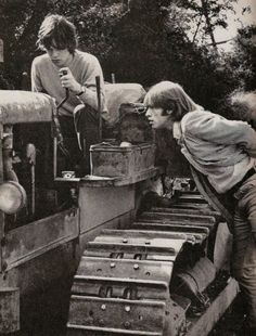 1960s: two parts of The Rolling Stones, with a large machine and sweetly confused faces.