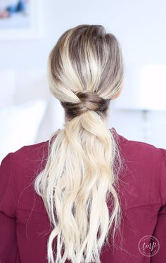 Cute and easy ponytail! You leave out a small section of hair near the nape of your neck and put the rest up into a ponytail.