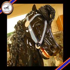 This is Joy, one of our hand carved wooden horses that will go on the carousel. Photo by Katy Levesque 2013.