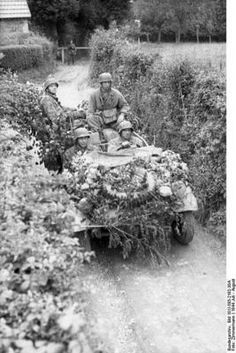 Four Fallschirmjagers driving a VW-Kübelwagen in Bocage Country, Normandy, France July/August, 1944