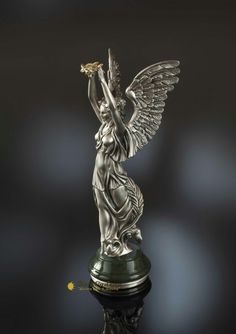 The figure of the Victory is made of gold and silver, and the press basis – from natural nephrite.
