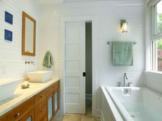 Add privacy in a small bathroom: use a sliding door to separate the water closet from the main room.