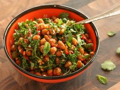 Roasted chickpea salad with kale, fresh herbs, pine nuts, and sun-dried tomatoes