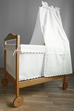 this kind of canopy over bed. very sheer white fabric hanging from rod on ceiling. gonna diy it.
