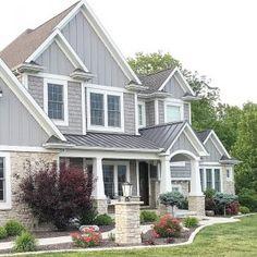 shake shingle style home. grey home exterior. mastic alcoa shingle