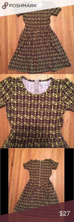 LulaRoe dress Amelia medium LulaRoe dress, new without tags, material has minor defect on bottom back near seem, ( see fourth image), dress can be taken to hide defect if desired or left alone. LuLaRoe Dresses