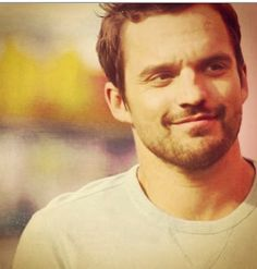 Jake Johnson. Not sure why I find him so attractive, but I do. He's like stubbly, grumpy catnip.