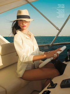 A floppy fedora is the perfect accessory for a day out on the ocean in Miami.