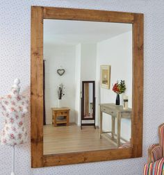 This Solid Wood Wall Mirror will add style and character to any home. A mirror…