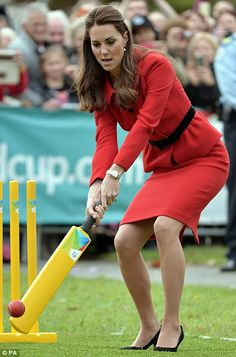 Almost bowled over! The Duchess of Cambridge narrowly avoids getting hit in the head by a ball as she plays cricket in heels and a suit during game against husband Prince William | Mail Online