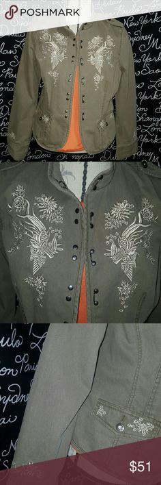 NWOT NAUTICA embroidered jacket NWOT embroidered dark brown jean jacket with impressive detail,  light cream embroidery with a shine,   very unique studded hook and eye closes the front. Two pockets in the front.  100% cotton, machine wash cold inside out.  You cannot go wrong with this item in your closet.  Pictures do it no justice.  25 inches long, sleeves 25.5 inches long.  PLEASE ASK ANY AND ALL QUESTIONS BEFORE PURCHASING THIS ITEM Nautica Jackets & Coats Jean Jackets