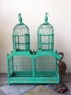 Vintage twin birdcages on sale on etsy from AlteredArcheology (already sold, much to my chagrin)