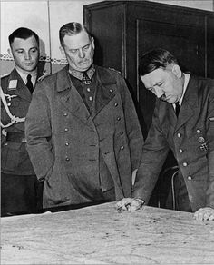 "Hitler (right) and General Field Marshal Keitel (center) are studying the map in the process of preparing the plan for attacking the USSR - ""Barbarossa."" On the left in the background is Hitler's Luftwaffe adjutant Nicholas von Below."