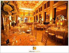 Amber uplighting and chiavari chairs for a beautiful wedding reception