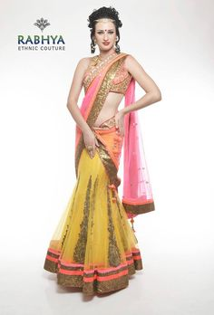 Style Code: RUJ 570 – Yellow net wraparound saree with Chantilly lining and nicely embellished kalis with aari and highlighted with cut dana and Swarovski . The border of the sequin fabric and neon tapes. The set comes with neon blouse and dupatta.  Just log on to: Rabhyaethnic.com or visit our store at: E-18, South Ex-II, New Delhi.