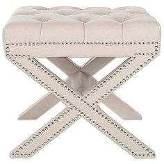 The Cleo X Bench Ottoman by Safavieh is a transitional update of the classic X-bench. Dressed up with a biscuit tufted top and upholstered in taupe linen with silver nailhead detail, this classic ottoman makes a pretty addition to any room in your home.