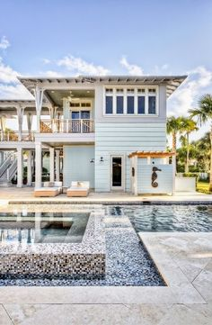 Beach house. i love the full balcony. i'd either want this some where in the keys or shoot west coast of Florida. A girl can dream right?