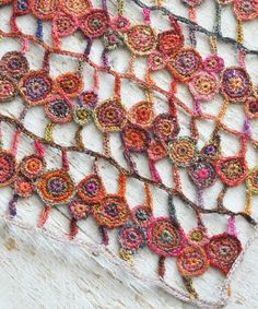 Sophie Digard crochet scarf. Gorgeous! I would go for different colors, but the pattern and color variation here is just lovely.
