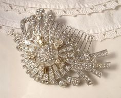 "Hi and welcome to ""AmoreTreasure"".  Up for sale is a beautiful beyond belief hair comb made from a large vintage Art Deco clear crystal brooch.  It is even prettier in person!  The comb has such a classic Art Deco / Art Nouveau design.  Loaded with clear round cut pave crystals, it has SO ...    $119.99"