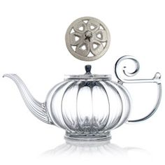Love the design ~ MY BEAUTIFUL TEAPOT  glass teapot - cast-iron silver lid ~ Round, lofty, generously fluted and finely chased, MY BEAUTIFUL TEAPOT combines hand-blown glass with a cast-iron colourfull openwork cover.  It brings to mind all the delights of a mild flirtation, just as it brings to the mouth rich flavours and heady aromas.  In its wake it leaves an evocative swirl of shared moments and soft light.