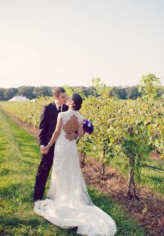 Love how her dress looks perfect in the vineyard. #rusticglamwedding #rusticglam #rusticweddingideas #uniquenjvenues #lauritawinery #purplewhitebouquet #purpleandwhitewedding #vineyardweddings #feuzareis