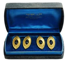 "Tiffany & Co Art Nouveau 18 Kt.Gold Cufflinks  |  early 20th century, set with four oval cabochon blue #sapphires, (likely genuine), marked ""Tiffany & Co"", 18 kt. yellow gold, approximately 14.73 mm., 15.7 grams, with original Tiffany & Co fitted box, cufflinks with minor wear, box with some wear.  