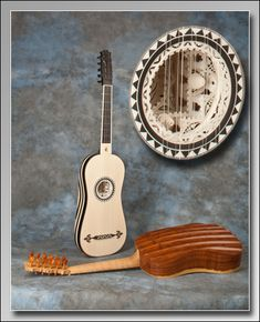 The above image shows a vaulted-back Italian baroque guitar – a 'Checchucci' model – that we made for Alex McAllister, a player in Philadelphia (with a detail of its rosette) alongside an exact copy of the famous 'Chambure' vihuela made for the Cité de la Musique, Paris, the owners of the original instrument (E.0748). The vihuela was played for the first time in public by Miguel Henry at a conference which took place at the Cité on Saturday November 27th 2010.