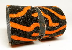Joxasa Shagreen leather cuffs.
