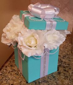 New to my store is this Tiffany & Co. inspired table centerpiece. A 6x6x6 size box painted Tiffany Blue and filled with white roses or pink roses