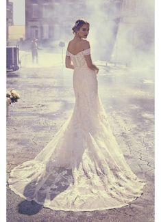 7490c49bd04 Six different types of hand-crafted lace appliques and beads take this  off-the-shoulder mermaid wedding dress to the next level. The sheer corset  back and ...