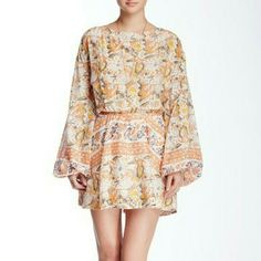 """Free People Sun Printed Dress Breezy sillouette with open back, roundneck, and long sleeves. Elasticized waist and side slash pockets. Fully lined. Bust: 47-38"""", natural waist: 29-30"""", drop waist: 32-33"""", hips 39-40"""". About 15"""" from natural waist to hem. Rayon and cotton. Says size M but could also fit L. Free People Dresses"""