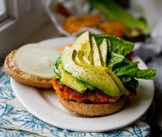 "Sweet Potato Veggie Burger-- it's also vegan.   I am gonna try this! It looks tasty...love me some sweet pot's, and avocado, and ""burgers""...."