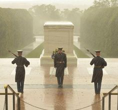 Honor guard at the tomb of the Unknown Soldier during Hurricane Sandy.