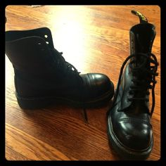Dr. Doc Marten 8761 Black Leather Boots I have been the only owner on these boots and I have had them for 10 years. The great part of Dr. Marten's is they never go out of style and last forever. You will be stomping around in these for years to come. These are black leather, steel toe, air sole, 10 eyelet, have original laces and totally awesome. The soles are in perfect condition. There are a few scuff marks on the toes, which I have pictured, other then that you can hardly tell they aren't…