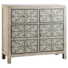 A lovely addition to your dining room or den, this elegant cabinet showcases a hand-painted filigree front in slate blue and white smoke hues.