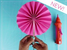 Paper Fans fun and easy craft for kids to do (you have to scroll down the page to the Paper Medallion Fans video)