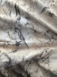 Reminds me of fabric, I wonder how I could dye it like this.. How soft stone can look.