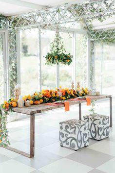 Citrus Wedding reception ideas for table decor and flower arrangements.