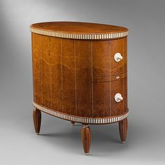 Cabinet Émile-Jacques Ruhlmann (French, Paris 1879–1933 Paris) Date: ca. 1918–19 Medium: Amboyna, ivory Dimensions: H. 27 1/2, W. 16 1/2, D. 28 1/2 in. (69.9 x 41.9 x 72.4 cm) Classification: Woodwork