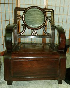 Chinese Art Deco rosewood armchair with marble medallion